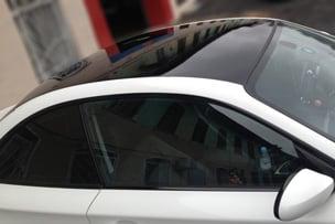 Оклейка крыши автомобиля чёрной глянцевой плёнкой